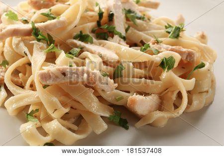 Tasty Italian chicken alfredo on plate, closeup