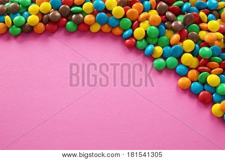 Colorful candies on color background
