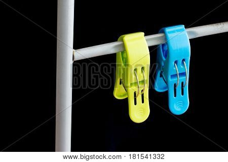 clothes peg on black background Outside Hang to dry on a laundry line
