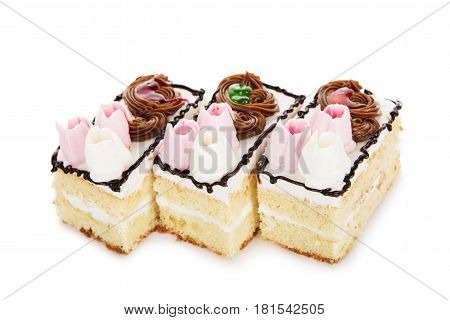 Biscuit White Cake Decorated With Cream Flowers Isolated On White