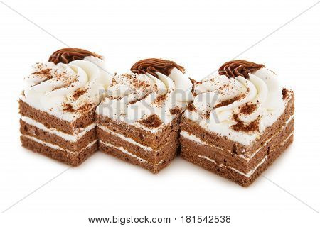 Chocolate Biscuit Cake Decorated With Cream Flowers Isolated On White