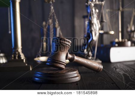 Law and justice theme. Mallet of judge and scale of justice. Statue of justice - Themis. Legal code. Wooden table.