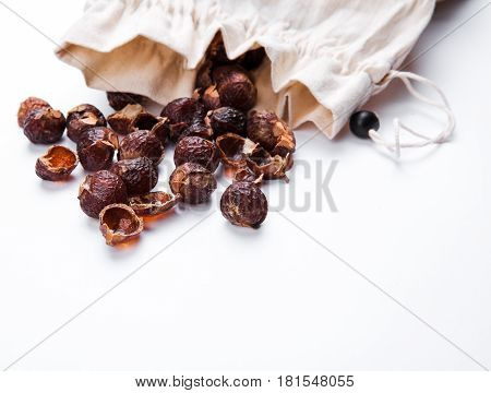 soap nuts on a white background poured from the bag. Care products. natural, organic and