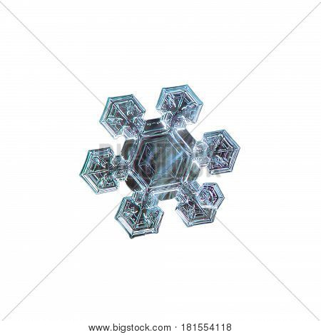 Macro photo of real snowflake: medium size snow crystal with six short, broad arms and large, flat central hexagon with simple inner pattern. Snowflake isolated on white background.