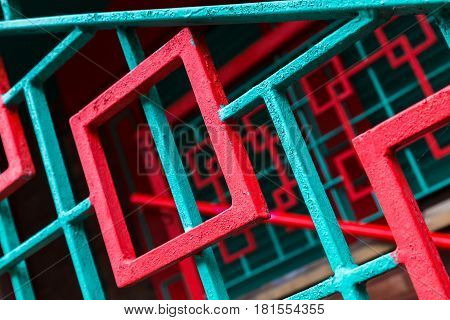 Red & aqua coloured abstract-like railings seen up close along Nelson Street in the heart of Liverpool's Chinatown.