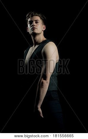 Handsome Man Posing In Unbutton Vest With Muscular Torso