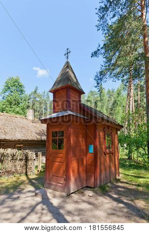 RIGA LATVIA - JUNE 13 2016: Small chapel (circa 1920s) of Kurcini village in Latvia. Exhibited in Ethnographic Open-Air Museum of Latvia since 1986