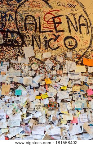 VERONA ITALY - MAY 1 2016: Part of the wall covered with love messages in Juliet house Verona Italy