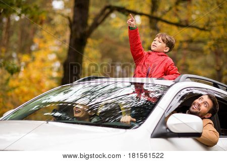 Adorable Boy Standing In Car Sunroof