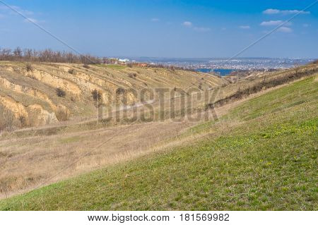 Sunny landscape with soil erosion at early spring season in outskirts of Dnepr city Ukraine