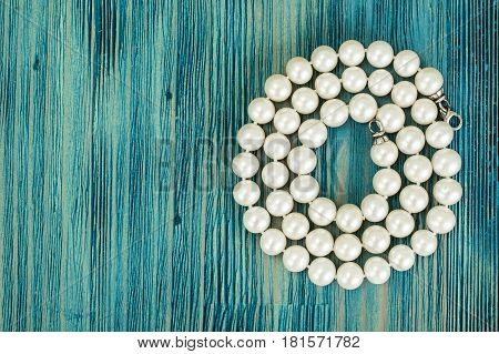 Beauty Pearl Necklace on wood. Studio Photo.