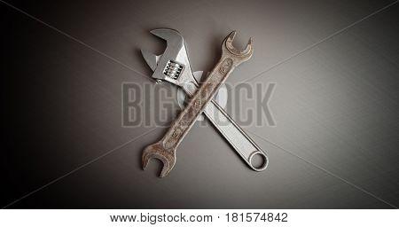 Image of laptop and metal tools repair equipment