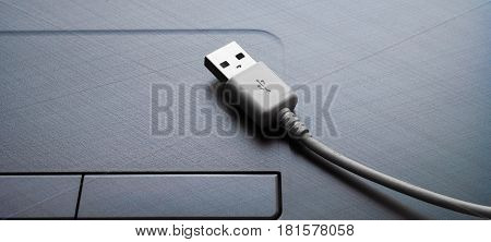 Computer equipment computers cable USB touchpad close up
