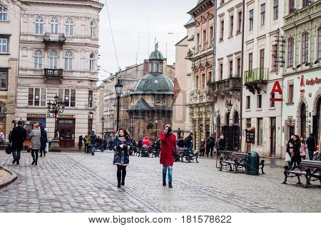 LVIV UKRAINE - Feb 21 2017: Morning Lviv. Road to the Market Square. Tourists walk through the old town. Picture taken in the morning during a trip to Lviv.