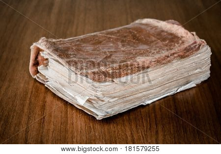 old book of poetry on a wooden table