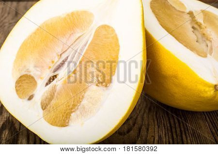 Pomelo-healthy fruit on wood background. Studio Photo