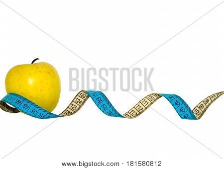 dieting. green yellow apple with leaf and measuring tape isolated on white