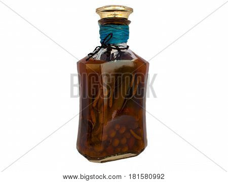infusion of herbs in a brown bottle on white background