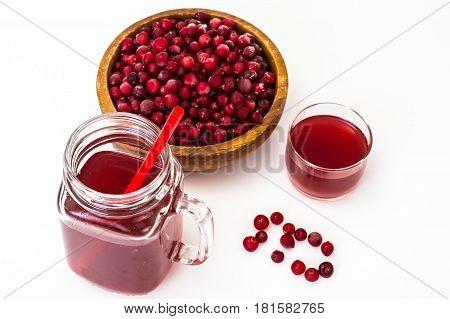Cranberries and juice on white. Studio Photo