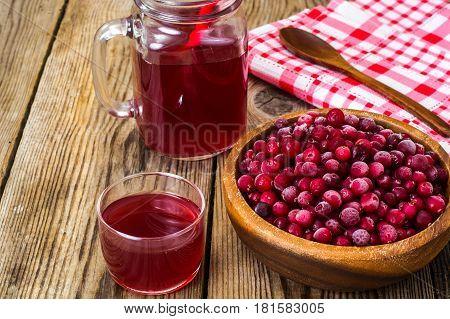 Cranberries and juice on wood. Studio Photo