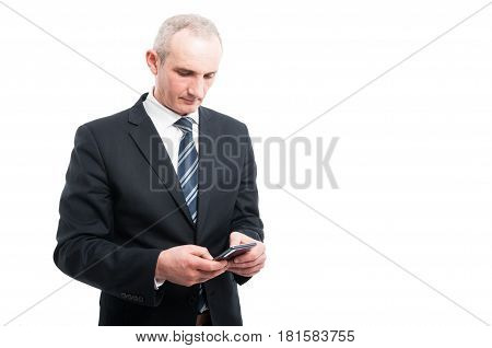 Portrait Of Senior Elegant Man Holding Texting On Smartphone