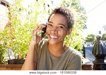 Happy African Woman Talking On Mobile Phone