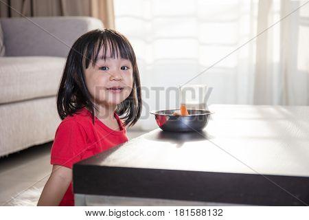 Asian Chinese Little Girl Having Breakfast With Milk