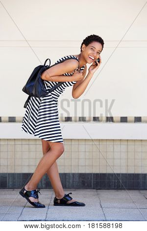 Full Body Black Woman Walking And Laughing With Cellphone