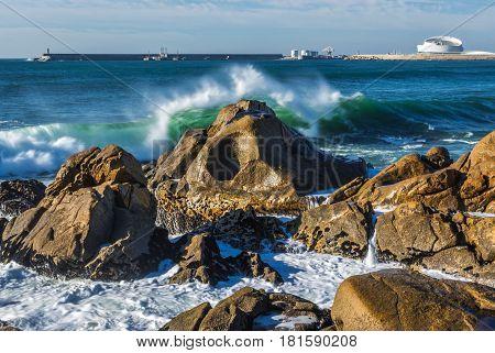 Rocks of Atlantic Ocean seen from beach in Porto Portugal