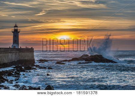 Sunset over Atlantic Ocean and Felgueiras Lighthouse in Porto city Portugal