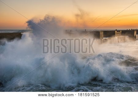 Big waves smashes on breakwater in Porto Portugal