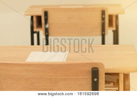 test paper on wood table of classroom in secondary education