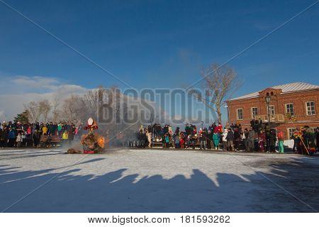 Sviyazhsk, Russia - 26 February 2017: burning of winter's effigy - Maslenitsa Event - crowd looking to pagan rite, wide angle, telephoto
