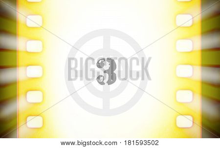 Cinema film strip with movie countdown and light rays. Movie startup concept close up image
