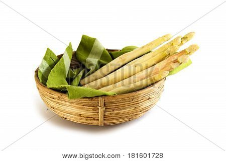 organic asparagus spears fresh crop in a basket with a green towel isolated on a white background selective focus narrow depth of field