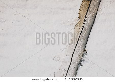 Texture of a brick wall with wooden beam, rustic background