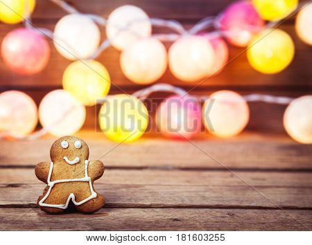 Christmas food, Gingerbread Man on a wooden background. garland for the new year and