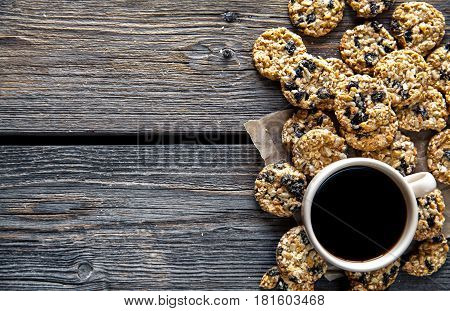 cookies with chocolate and coffee on a wooden background. drink, sweets, breakfast and