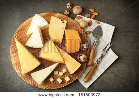 Cheeseboard with nuts on grey table