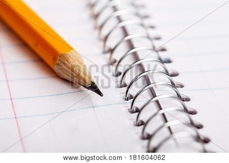 Pencil and a notebook up close and