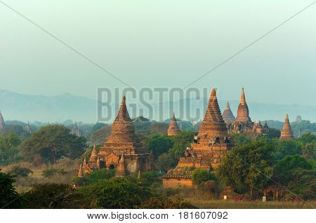 Beautiful Ancient land with thousands of ancient temples tourists waiting for sunset on ancient Temple in Bagan Myanmar color tone effect.