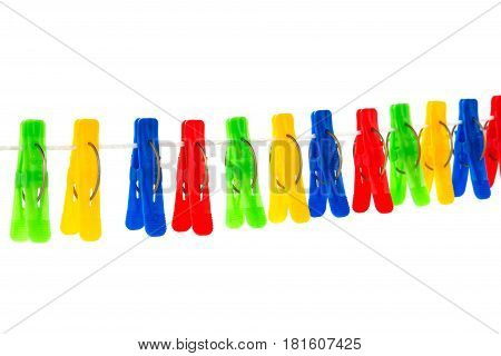 Some Colored Clothespins On A White Background