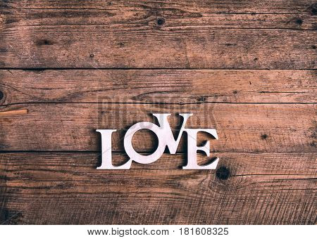 Word ''love'' on a old wood planks. St. Valentine's Day and