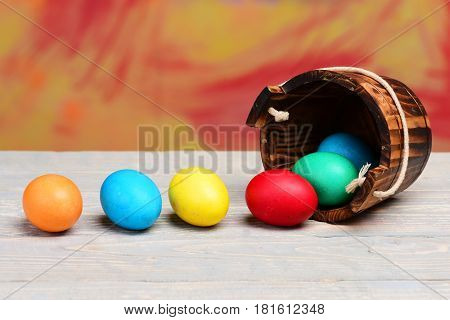 Painted Easter Colorful Eggs In Wooden Bucket