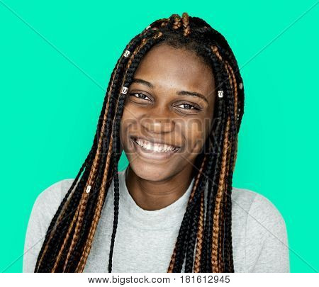 Young african descent girl with dreadlocks smiling