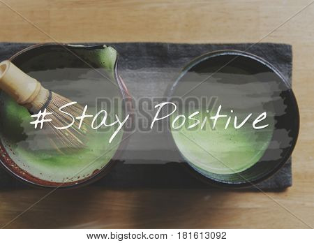 Hands with Japanese Green Tea and Stay Positive Word