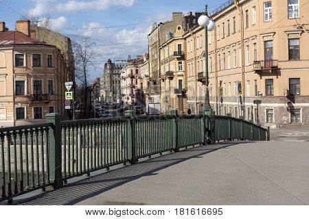 prospect the bridge on the river Fontanka view of the city of St. Petersburg buildings street cars on the road the Windows lamppost Sunny day
