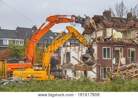 Two Demolition Cranes At Work