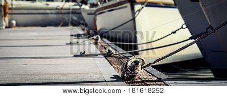 Cleats and sailboats at a marina in Coronado California.