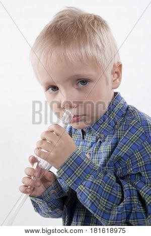 Boy And Nasal Aspirator